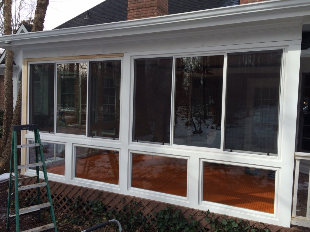 Belk builders completes a screened porch to sunroom for Porch sunroom