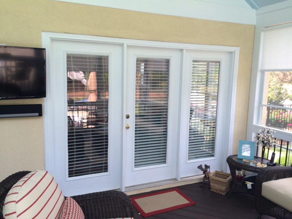 In addition to replacing the windows, the homeowners decided to exchange their cumbersome French door into their kitchen from the screened porch with a new, space-saving sliding glass door.
