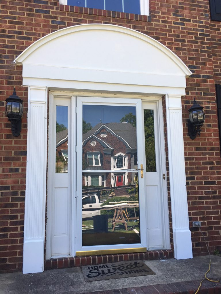 This custom made Hardie and PVC door surround is low maintenance and adds tons of curb appeal to this South Charlotte home.