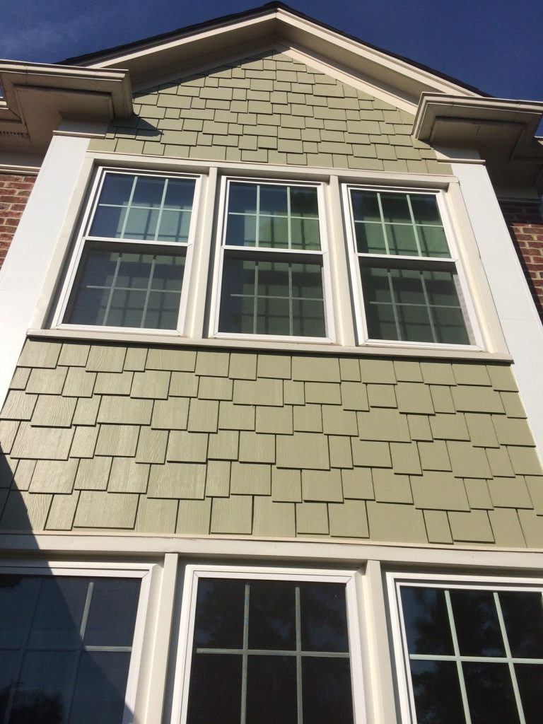 Installation of Hardie Staggered Shingles by Belk Builders