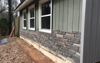 Details of insulated board and batten and brick vinyl combination