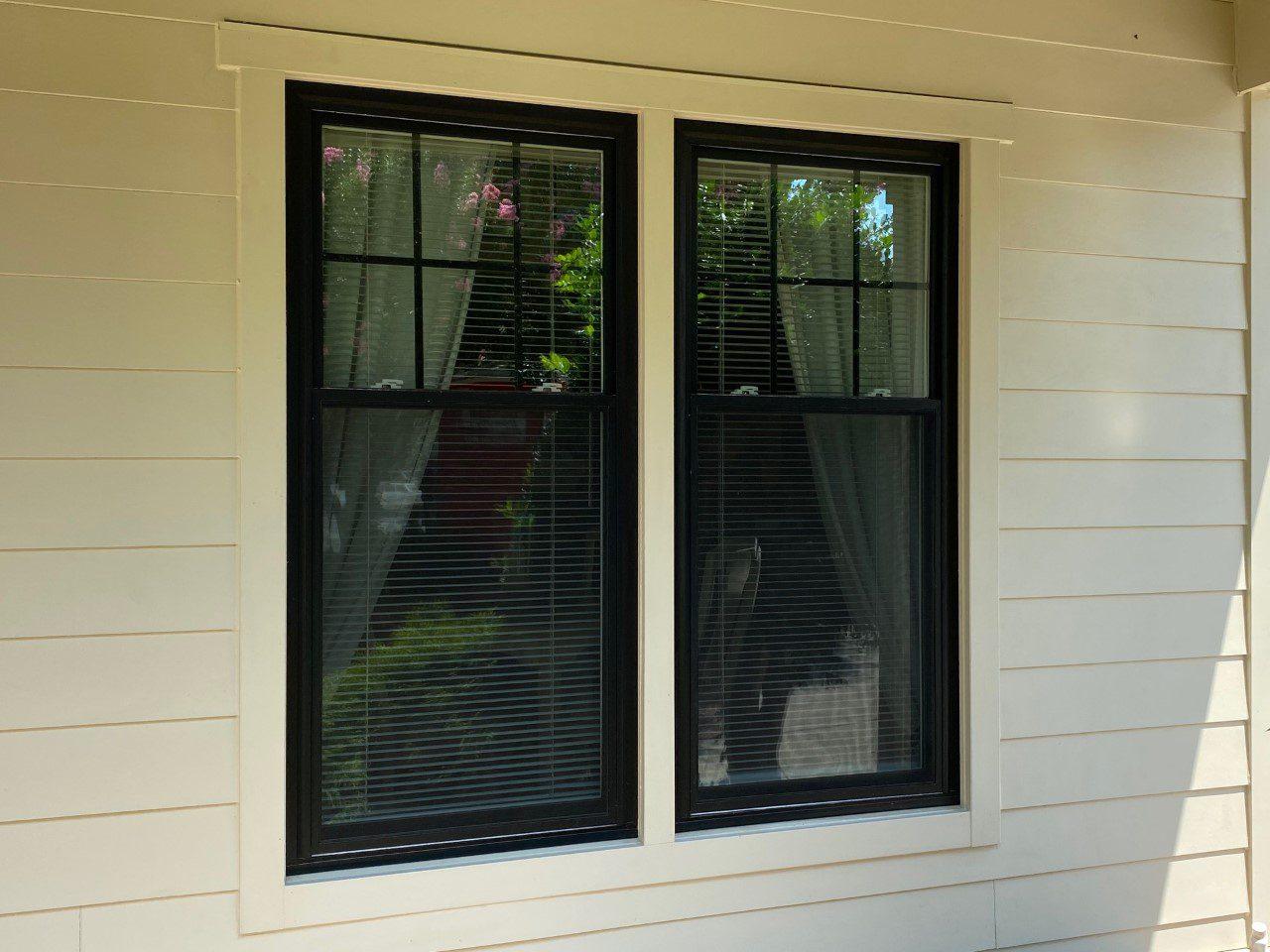 white siding black windows