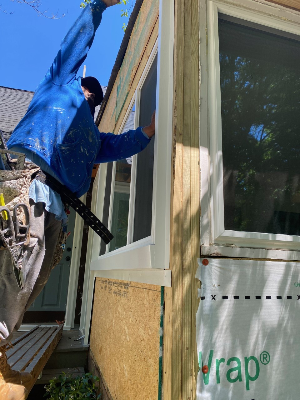 removal of masonite and new siding installation underway